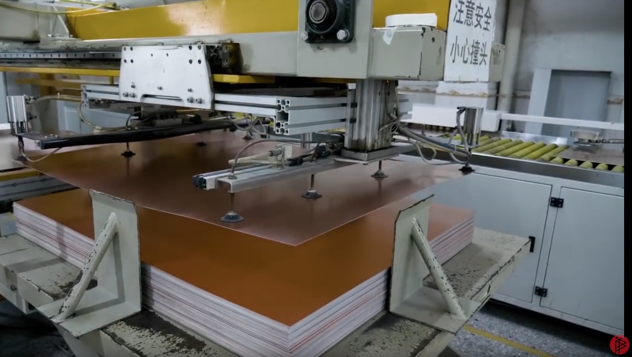 Inside A Huge Printed Circuit Board Factory In China Pcb Cutting Machine Suppliers The Boards Are Sent Through Automated Machines That Gigantic Saws Sheets Into Size Required By Being Produced